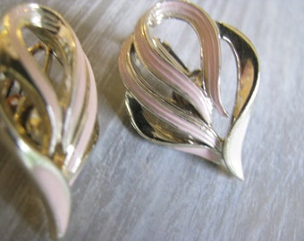 Pink ribbon clip  earrings. look as if designer signed but has worn and can not read designer