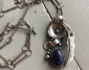Vintage Native American Pietresite Feather Pendant on Handmade Chain. Sterling silver pendant on long short chain.
