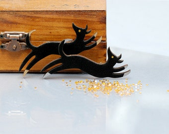 Black Flock and Silver, Gold Jumping Dog brooch.