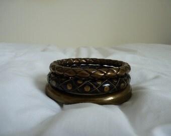 Three vintage brass bangles