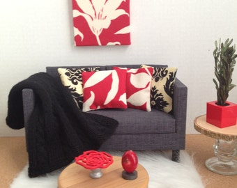 InstaRoom in Red and Black with wall art, throw blanket, coffee table, cake stand, coral sculpture and 4 pillows for sixth scale