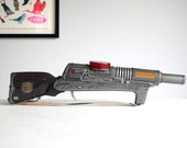 RESERVED - retro tin tiger friction toy ray gun rifle