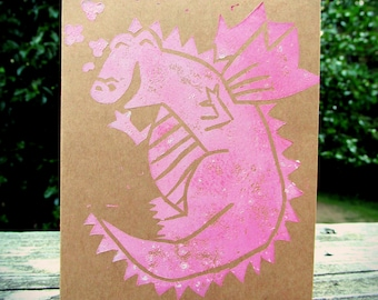 Set of 3 block print dragon cards in rose quartz pink ink on brown cardstock. 3 blank cards and envelopes.