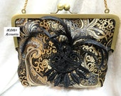 STYLISH EVENING HANDBAG in Black and Gold Satin Brocade with Curled Biot Feathers and Applique on a Brushed Gold Frame Formal Bridal Prom
