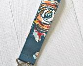 Teal floral key fob. Teal wrist strap key chain. Fabric wristlet key chain.