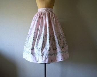 SALE . 1950s novelty print skirt . vintage 50s skirt