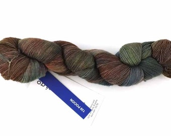 Malabrigo Merino Wool Lace Yarn, Pocion, black, red, wheat, color 139