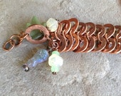 Infinite Wisdom copper bracelet with vintage czeck glass owl and lucite grape leaf