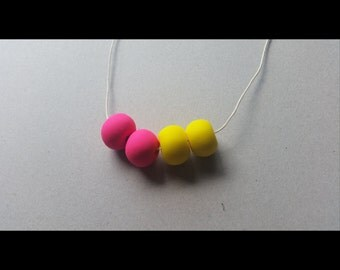 Bright pink/yellow clay necklace