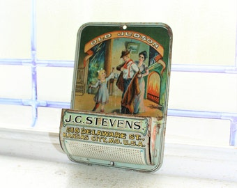 Old Judson J C Stevens Tin Litho Match Holder Antique Advertising