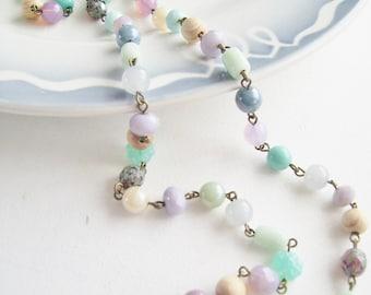 A pastel coloured beaded boho style necklace...