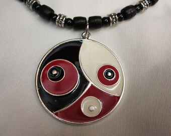 Bold Black Red and White Circle Pendant set on Black Red and Silver Beaded 17 Inch Necklace with a Sturdy Magnetic Clasp