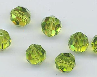 Twelve Swarovsk crystals in a rare reprise of the discontinued color light olivine AB - art. 5000 - 8 mm - light olivine AB
