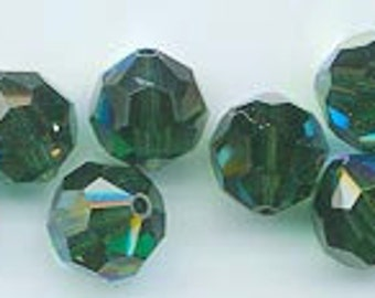 Twelve vintage Swarovski crystals: art 5000 - 8 mm - discontinued color turmaline AB