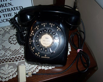 Vintage 1980's Black Rotary Telephone...Works Great..Except the Ringer....Looks Very Retro and Very Cool...Clean...