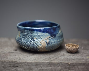 Wood fired stoneware blue glazed ceramic  pottery tea bowl cracked surface
