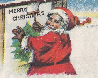 "Ca. 1920's ""Santa Hanging Poster"" Christmas Greetings Postcard - 2312"
