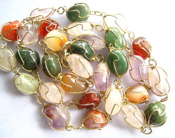 """30"""" Tumbled Stone Necklace. 30 Individually Wire Wrapped Mixed Semiprecious Stones Connected by Small Oval Links.  Gold Finished Metal."""