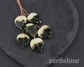 6 ivory and frit lampwork glass leaf headpins.