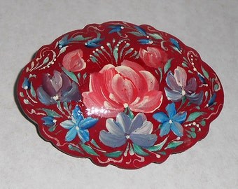 The brooch in Russian style with flowers in handmade red