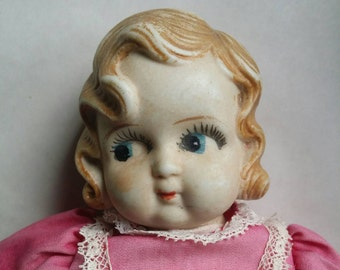 Vintage doll in a pink dress