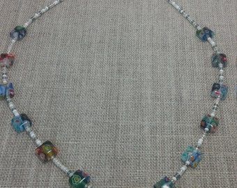 childs necklace made with beads and glass beads