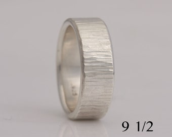 Hammered sterling silver band, 8 mm wide, size 9 1/2, #743.
