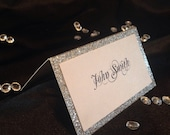 Escort card or place card in silver glitter and white shimmer paper