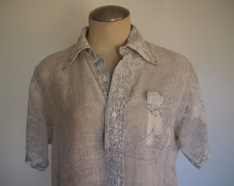70s vintage unisex white cotton gauze collared half button up with hawaiian motif (there are boobs too)
