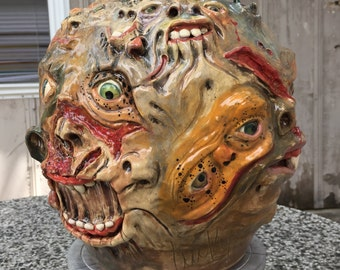 MONSTOSITY FACE JUG - wheel thrown, hand altered and sculpted. Just a lot of friendly little faces to bighten your day.