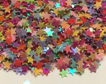 bag of tiny carnaval color assorted star confetti mix , 3 mm (21)+