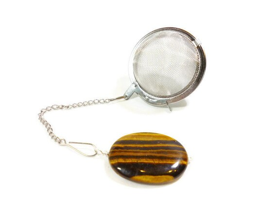 tea infuser with oval tiger eye charm
