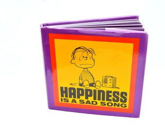 Peanuts Happiness Is A Sad Song by Charles M. Schulz
