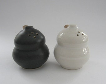 Salt and Pepper Shakers Black and White Stoneware Salt and Pepper Shakers.
