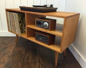 New mid century modern record player console, stereo cabinet with LP album storage. Avail in walnut, cherry, white oak or mahogany.