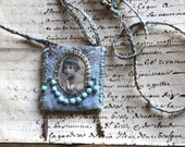 """Textile pendant: """"little girl with a blue hat"""""""