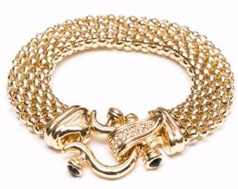 "Gold ""Sika"" Clasp Bracelet"