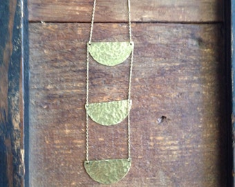 Long hammered half moon necklace