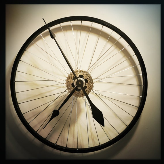 Items similar to bicycle wheel clock cycling gift for men for Bicycle wheel wall art