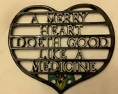 Vintage Antique wall hanging trivet 1960s black iron a merry heart doth good like a medicine
