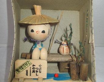 Japanese artist wooden Kokeshi Doll Fishing on bench Japanese writing