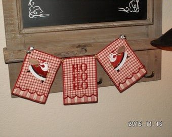 Christmas banner or bunting with Santa proclaiming ho ho ho and jingle bells at the corners