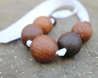 Wooden beads necklace - beads are welded in olive oil - on the white ribbon - eco friendly - teething necklace