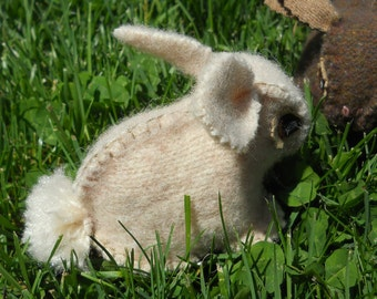 Soft, felted wool bunnies are hand crafted from recycled wool garments and come in a variety of beige and brown.
