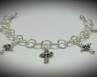 Silver link bracelet with 5 dangle crosses