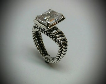Silver ring with 9mm x 11mm emerald cut white topaz