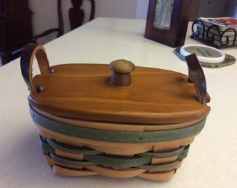 Wicker basket with wood lid and leather handles