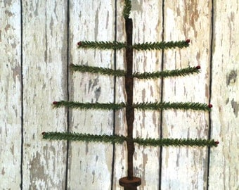 Primitive Faux German Single Feather Tree with rusty star and red pips