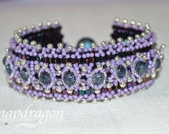 Heavily beaded purple and lilac beaded Babylon cuff bracelet