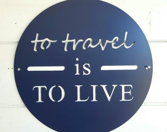 15 inch To Travel is to Live metal sign
